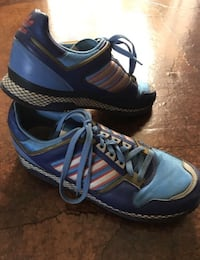 Blue-and-black adidas low-top sneakers