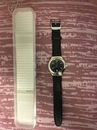 Round silver analog watch with black leather strap Richmond