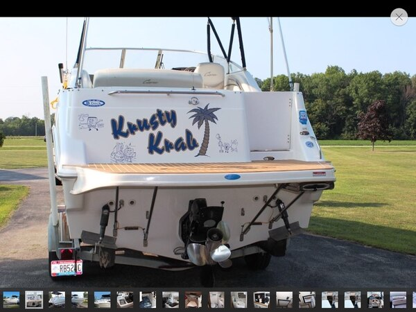 White and blue cabin cruiser boat