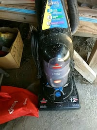 black and red Bissell upright vacuum cleaner Panama City, 32405