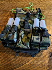 green and black camouflage tactical vest