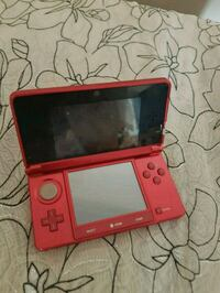 red Nintendo DS with game cartridge Winnipeg, R3M 1Y7