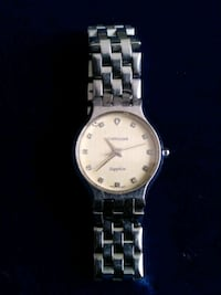 round silver-colored analog watch with link bracelet Calgary