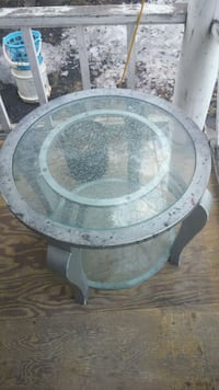 Solid metal table with beveled edge round glass to Winnipeg, R2L 1H2