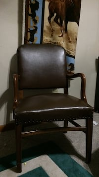 dark brown leather armchair with wood arms $40.00 each I have 2, they make a nice set