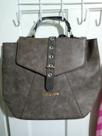 brown and black Michael Kors Knap-sack Hartford, 06114