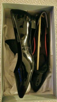 pair of black patent leather closed-toe flat shoes with brown box Mississauga, L4T 1Y8