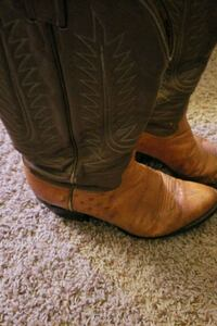 pair of brown leather cowboy boots 1131 mi