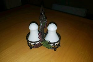 Salt and pepper shakers with grape rack stand