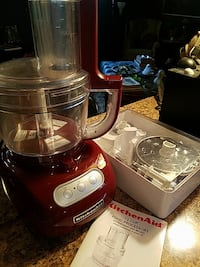 red KitchenAid food processor with manual