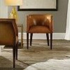 2 leather barrel chairs