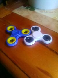 two blue and white 3-lobed fidget spinners Charlotte, 28208