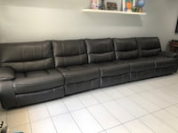 Grey leather couch. Five seater couch. Recliner. Fort Myers