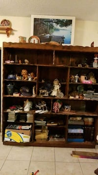 brown wooden shelf with assorted books Deltona, 32738