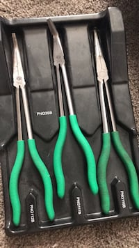 Four black and green handled pliers.