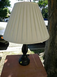 black base table lamp with cone-shaped white lampshade