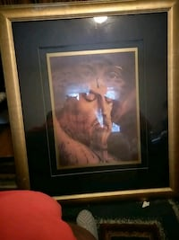 man in white dress painting with brown wooden frame Gastonia, 28052