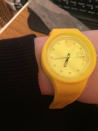Yellow round analog watch