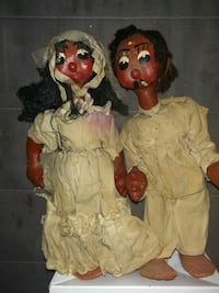 two black haired man and woman plastic dolls