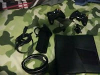 black Xbox 360 console with controllers Kingston, K7P 1A2
