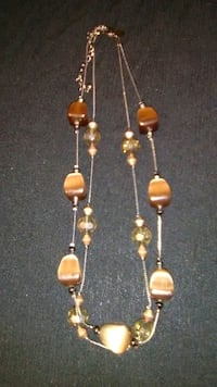 pair of gold-colored and white beaded earrings Colorado Springs, 80907