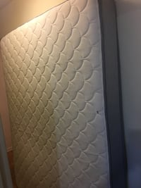 Brown and white quilted mattress