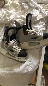 pair of white-and-black ice skates Burnaby, V5A