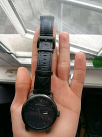 round black analog watch with black leather strap Oakville, L6M 4N8