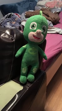 green and black frog plush toy