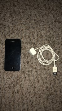 iPhone 4 with charger. Verizon carrier. Has a screen proctor on it. Albuquerque, 87109