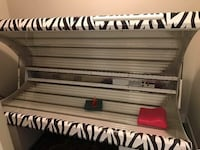 black and white zebra print tanning bed