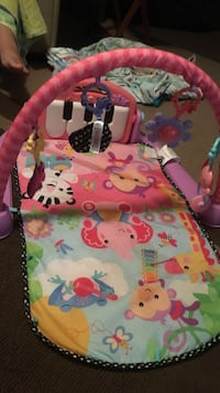 baby's pink, yellow, and teal animal printed kick and play piano