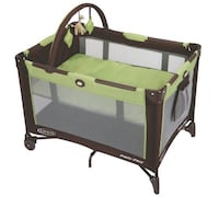 baby's black and green Graco pack n play Montreal, H1P 2L2