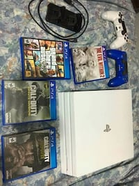 Sony PS4 Slim with controller and game cases 1348 mi