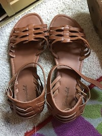 pair of brown leather sandals