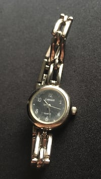 Round silver tone face Carriage analog watch with silver tone link Saskatoon, S7M 1W6