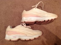 Pair of white-and-pink nike running shoes Winnipeg, R2N 4N6