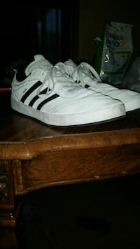 black-and-white Adidas low-top sneakers
