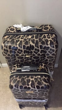 Two brown-and-black leopard skin print hard-shell luggage bags Edmonton, T5T