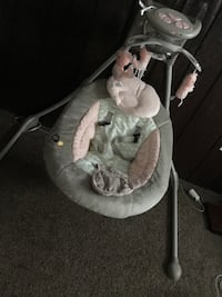 baby's gray and cradle and swing