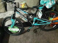 black and teal Huffy hardtail bike
