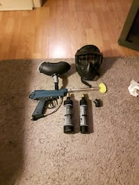 blue and black paintball gun with mask and air tan North Bay, P1B 3Z1