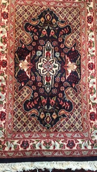 red, white, and black floral area rug Newtown