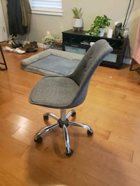 Grey cloth covered office chair.