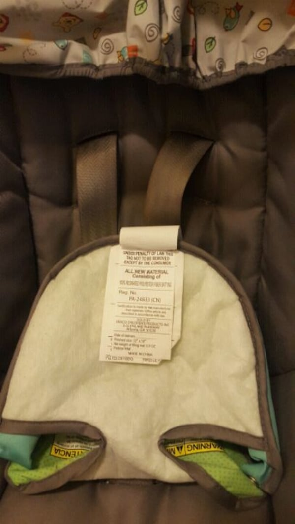 baby's gray and green car seat carrier. ee388361-9662-459b-8474-107cdd9d5a60