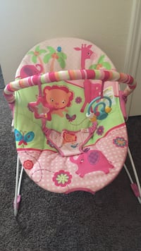 baby's pink and green jungle themed deluxe bouncer