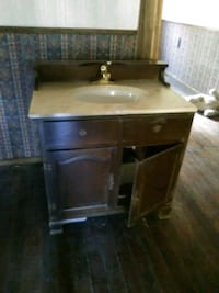 Molded Sink with cabinet base n facuet.  House sold. SO.. Hyde Park