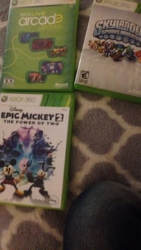 several Xbox 360 game cases