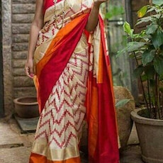 women's red and gold saree
