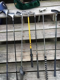 two golf drivers, three golf clubs and two golf putters Taunton, 02718